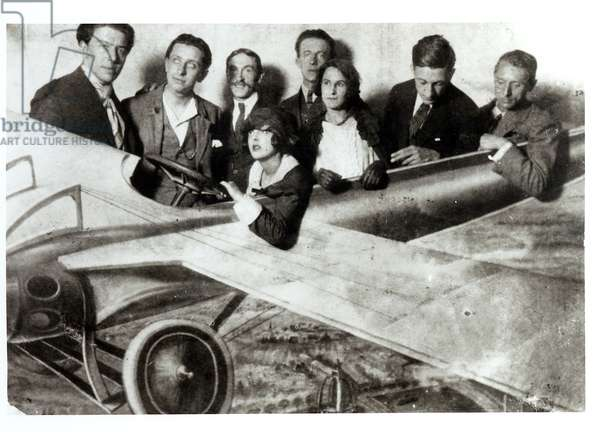 The Surrealist group in a plane in an amusement park. L-R: Andre Breton (1896-1966), Robert Desnos (1900-45), Joseph Delteil (1894-1978), Simone Breton, Paul Eluard (1895-1952), Gala Eluard (1894-1982), Max Morise (1900-73), Max Ernst (1891-1976) (b/w photo)
