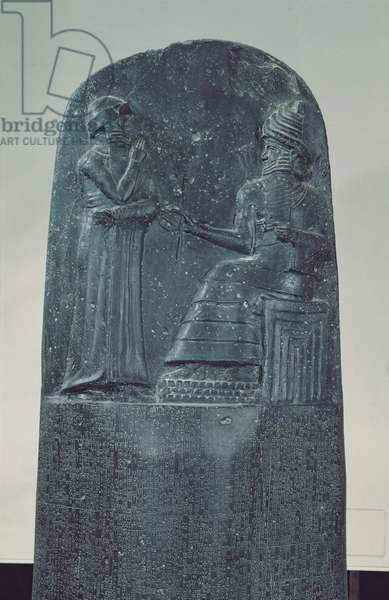 Relief Figure of the Sun God Shamash dictating his laws to King Hammurabi on his Famous Law Code, Old Babylonian Period, 1760 BC (basalt)