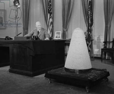 President Eisenhower giving a television speech about science and national security. He spoke from the Oval Office and displayed a nose cone of an experimental missile which had been into space and back. Nov. 7, 1957. A month earlier, the Soviet Union launched Sputnik.