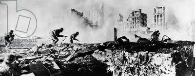 BATTLE OF STALINGRAD, 1942 Soldiers advancing under fire at the Battle of Stalingrad during World War II. Photograph, 1942.