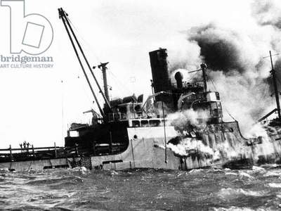 Sinking of the 'Houston' after bombardment by Castro's airforce, Bay of Pigs Invasion, Cuba, 1961 (b/w photo)
