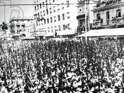 Parade of thousands of armed militia demonstrate the enduring character of the Socialist revolution, a dew days before the CIA-supported Bay of Pigs Invasion, 1961 (b/w photo)