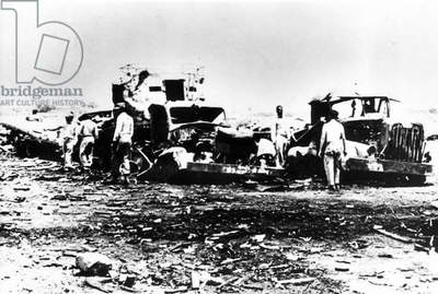 Destroyed truck at Ciudad Libertad airport, following the first air raid of the Bay of Pigs Invasion, Cuba, 1961 (b/w photo)