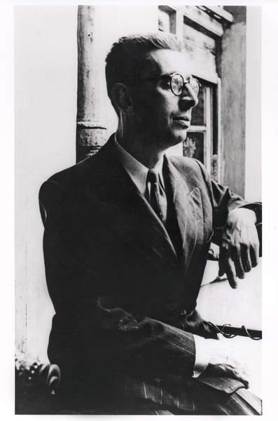 Image of a Portrait of Robert Desnos (1900-45) at 19 rue Mazarine, 1943 (b/w photo), Maar, Dora (1907-97) / French, Bibliothèque Littéraire Jacques Doucet, Paris, France, © Archives Charmet / Bridgeman Images.