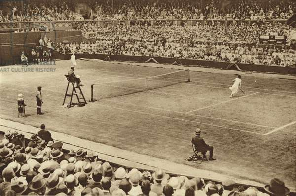 Suzanne Lenglen and Kitty McKane at work on the famous courts at Wimbledon (b/w photo)