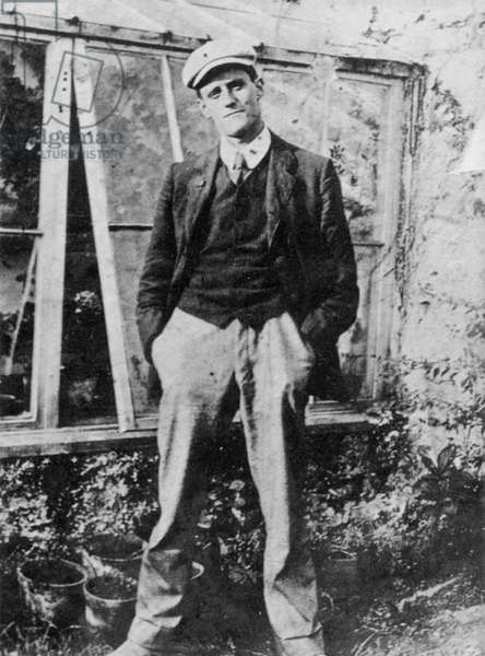 James Joyce in the garden of his friend Constantine Curran in Dublin, 1904 (b/w photo)