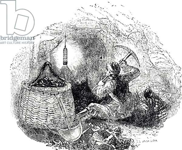 A miner digging coal with the aid of a Davy lamp