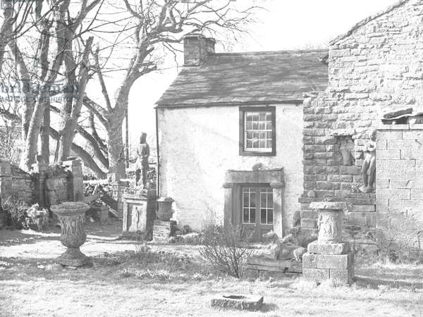 A view of urns and statues in the Italian styled gardens of Yew Tree Farm at Reagill, which was known locally as 'The Image Garden', 1930s-60s (b/w photo)