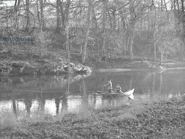 Two men in a rowing boat on a river fishing at Eden, 1930s-60s (b/w photo)