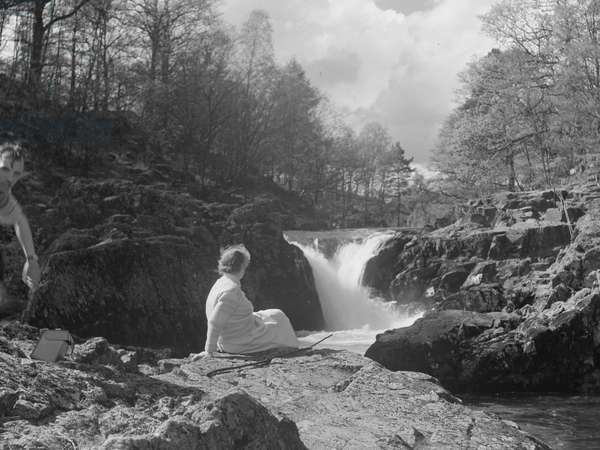Man and Woman sat in front of Skelwith Falls, 1930s-60s (b/w photo)