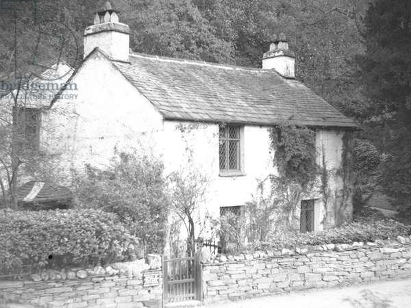 A view of the front façade of Dove Cottage, home to the poet William Wordsworth, 1930s-60s (b/w photo)