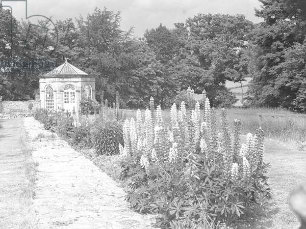 A view of the gardens at Burrow Hall including a small summer house , 1930s-60s (b/w photo)