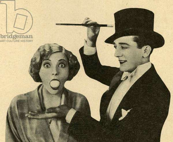 A magician and his assistant, 1920s (b/w photo)