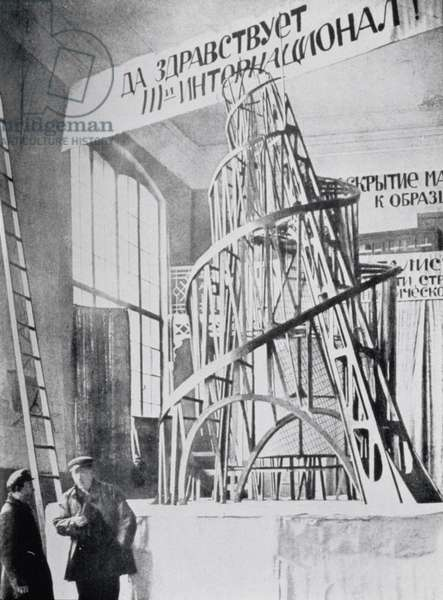Model of the Monument to the Third International, at an exhibition in Moscow in 1920, with Tatlin in the foreground holding a pipe, illustration from Ivan Puni's book 'Tatlin' (Protiv kubizma), 1921 (photo)