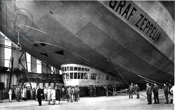 Postcard depicting The Graf Zeppelin preparing for launch from its hangar on September 9th, 1936 (litho)