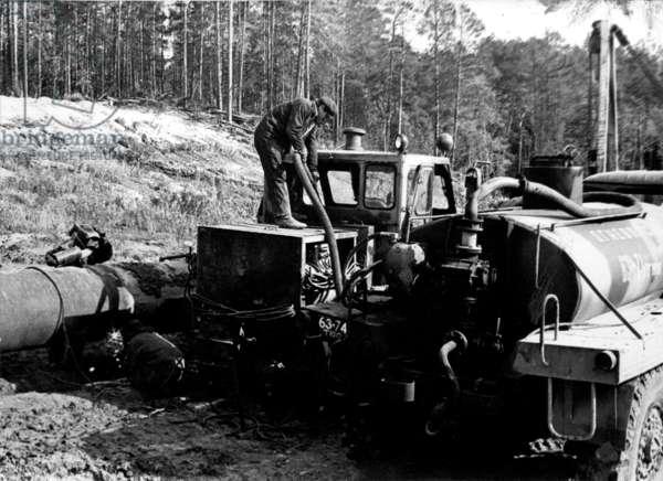 Fuelling, 1977 (b/w photo)