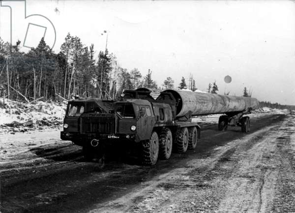 Pipes transported through the Taiga, 1977 (b/w photo)
