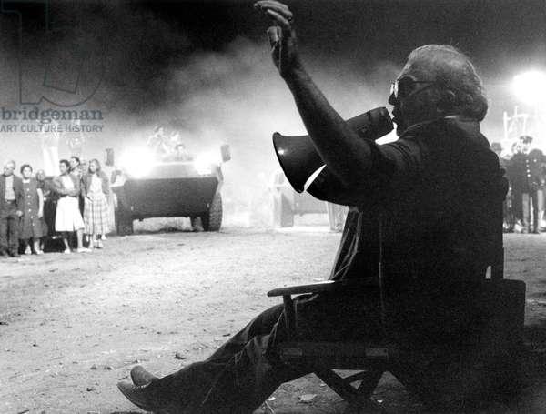 """Federico Fellini during the filming of the final scene of """"La Voce della Luna"""", Rome, 1989 (b/w photo)"""