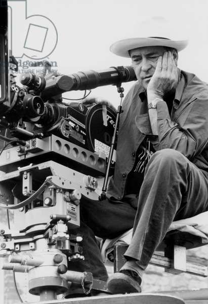 Bernardo Bertolucci on the set of