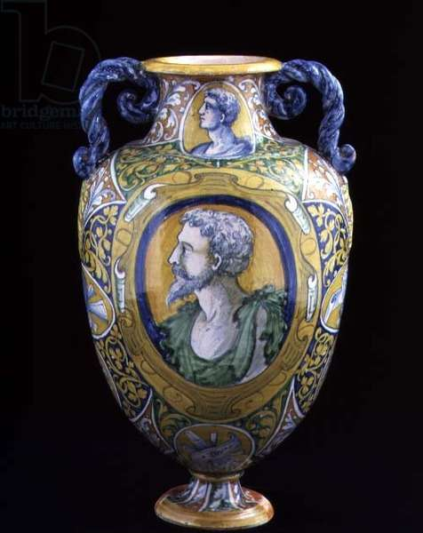 Maiolica two-handled vase decorated with plaques bearing profile portrait heads and trophies surrounded by stylised floral designs, Italian, made in Tuscany