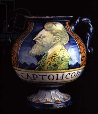 Maiolica two-handled pharmaceutical vase with a circular base and body decorated with a male portrait bust, stylised floral borders and text, Italian, made in Faenza, 16th century