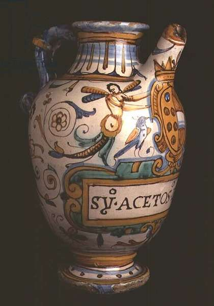 Maiolica pharmaceutical jar for vinegar decorated with the Medici coat of arms, grotesques and a stylised floral design, Italian, made in Montelupo, 16th century