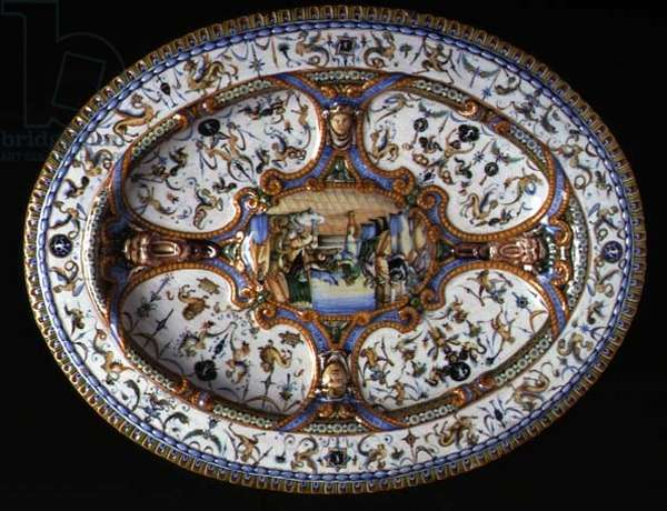 Maiolica tray with central plaque depicting a royal court surrounded by relief masks, four plaques and a border decorated with groteques, Italian (ceramic)