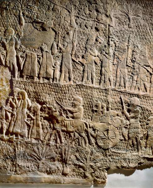 Exodus of the inhabitants of a city besieged, Low relief from the palace of Sennacherib (704-681 BC), king of Assyria. Nineveh, Iraq (stone)