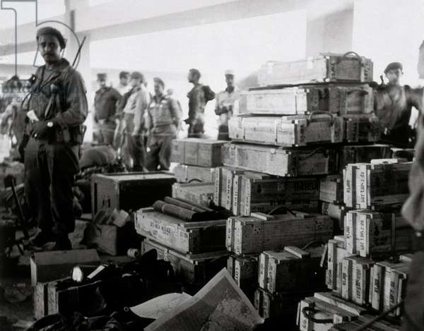 Cuban Revolution: members of the revolutionary movement led by Fidel Castro with crates of arms. 1959-1960 Cuba (b/w photo)