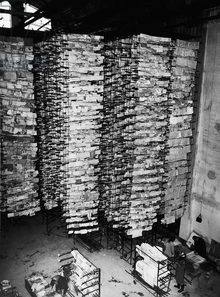 Rows of books and papers from the National Library salvaged after the flood of Florence, 4th November 1966 (b/w photo)