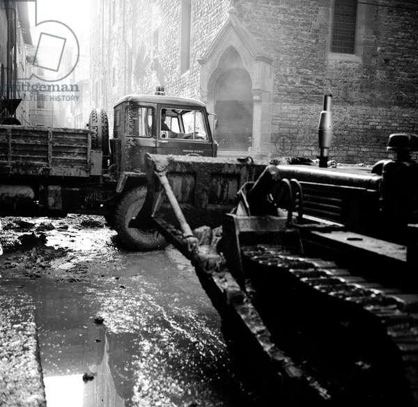 A bulldozer on a street in Florence after the flood, November 1966 (b/w photo)