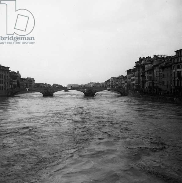 View of the Ponte Santa Trinita and the Arno Embankment with the collapsed parapet, after the flood of Florence, 4th November 1966 (b/w photo)