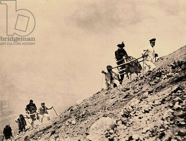 Tourists visit the slopes of Vesuvius, in two-wheeled carts pulled by men, after an eruption.