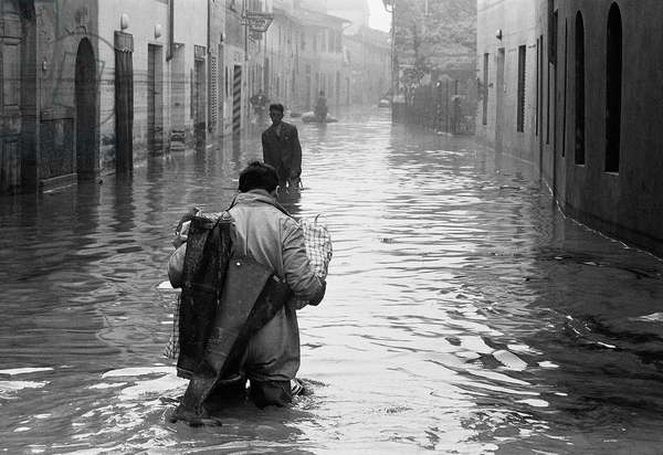 People wading through the flood in Florence, November 1966 (b/w photo)