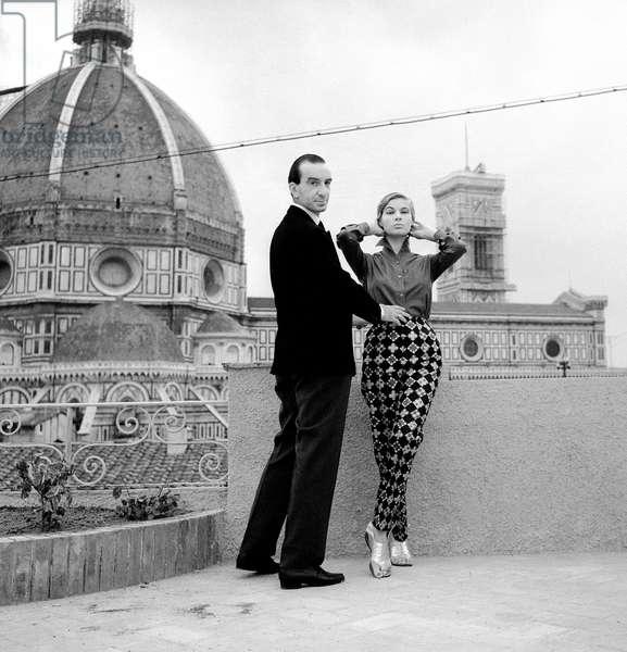 The fashion designer Emilio Pucci with a model on the terrace of the Pucci Building in Florence