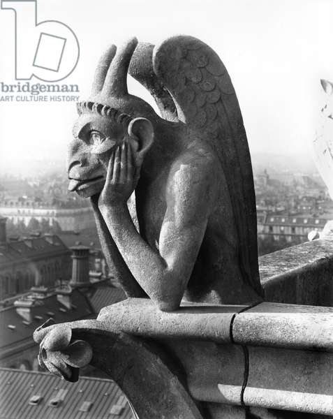 Demon gargoyle from the balustrade of the Grande Galerie of the west facade, replica of a 12th century original (stone) (b/w photo)