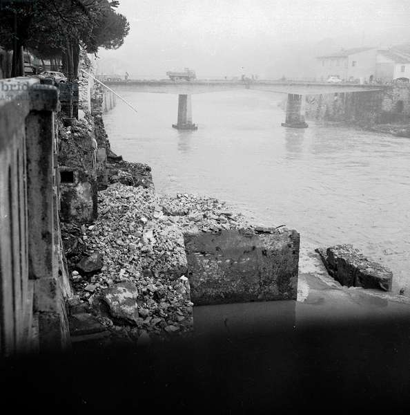 The river Arno after the flood of Florence, November 1966 (b/w photo)