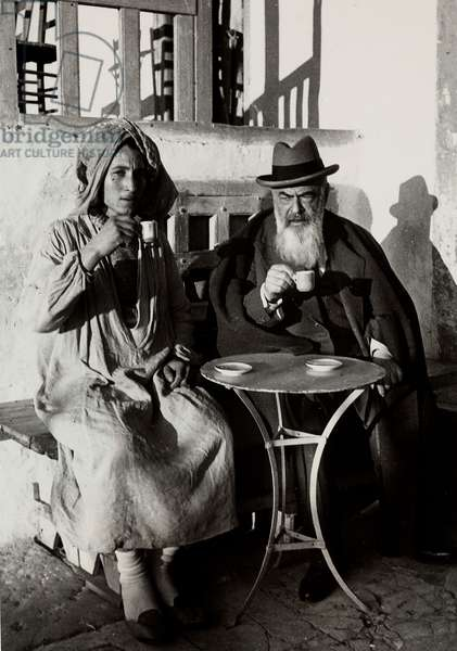 The writer Tristan Bernard, photographed seated at a cafe in the company of a native, during a voyage in Northern Africa.