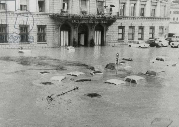 Cars submerged in water in Piazza Ognissanti in Florence during the 1966 flood
