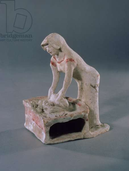 Woman kneading bread on top of a square slab, Greek, from Aulis, c.500-475 BC (clay with white slip and red pigment)