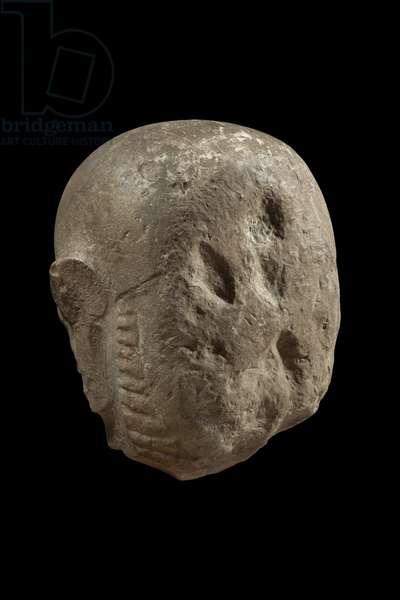 Head of statue of god Min (limestone)
