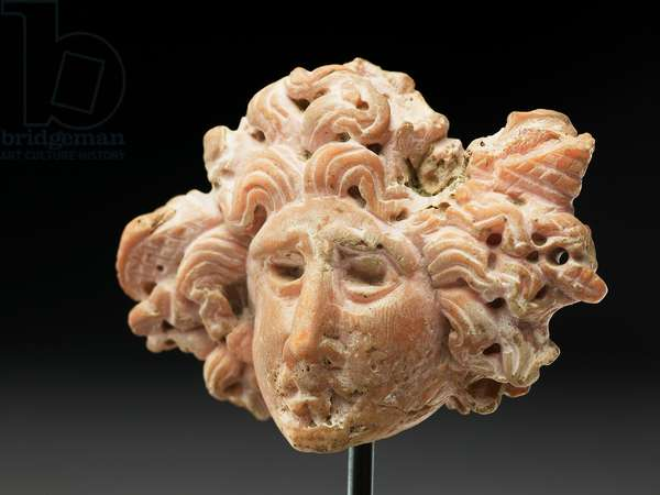 Head of Medusa, from Bactria or Gandhara, 2nd-1st century BC (pink coral)