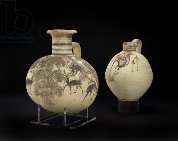 Bichrome IV barrel-shaped Cypro-Phoenician jug, and Phoenician vase with sacred tree, stags, crested birds and lotus flowers (ceramic)