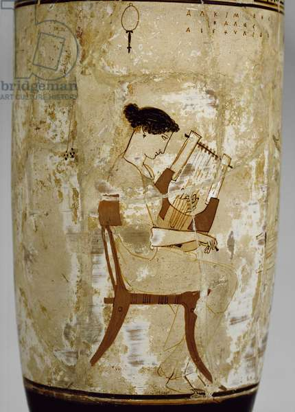 Attic white-ground lekythos decorated with a woman playing a cithara (glazed terracotta)