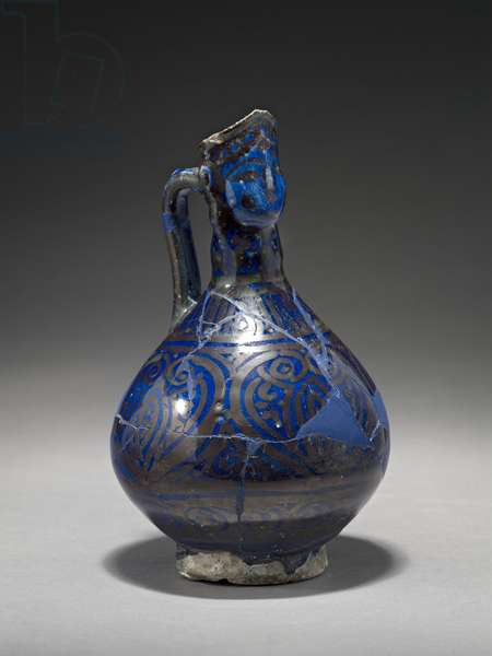Human-headed Jug, Iran, early 14th century ( stone-paste with gold lustre over blue glaze)