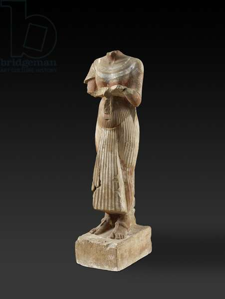 Figure of Pharaoh Akhenaten holding an offering table (carved & painted sandstone)