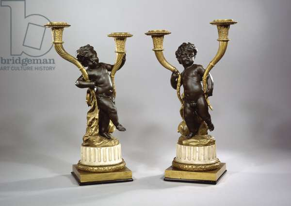 Two candelabra in the form of revelling putti, late 18th century (patinated & gilt bronze with Carrara marble socles)
