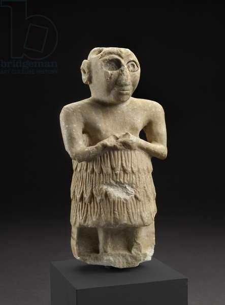 Statuette of a Sumerian man in an attitude of worship, Istabalat, Iraq (limestone)