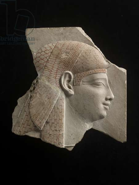 Sculptor's trial-piece showing a profile head of Isis or a Ptolemaic queen as Isis, details drawn in red, probably c.332-30 BC (limestone)