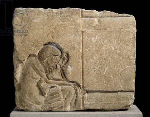 Limestone fragment carved in sunken relief depicting a sleepy servant in the palace (limestone)